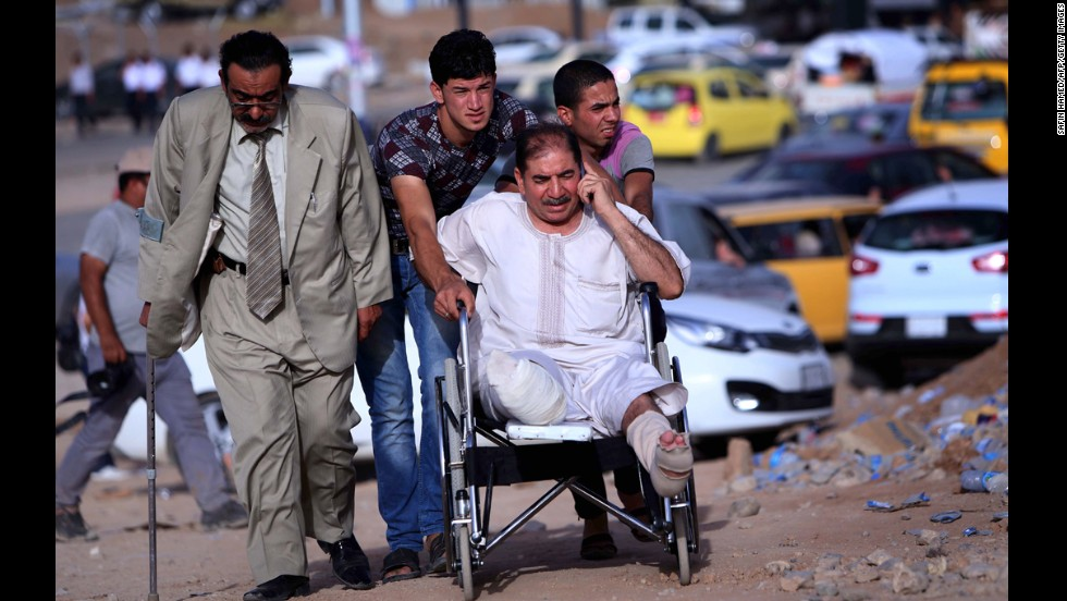 'A man in a wheelchair is among those fleeing the violence on June 11.' from the web at 'http://i2.cdn.turner.com/cnnnext/dam/assets/140611170333-02-iraq-0611-horizontal-large-gallery.jpg'