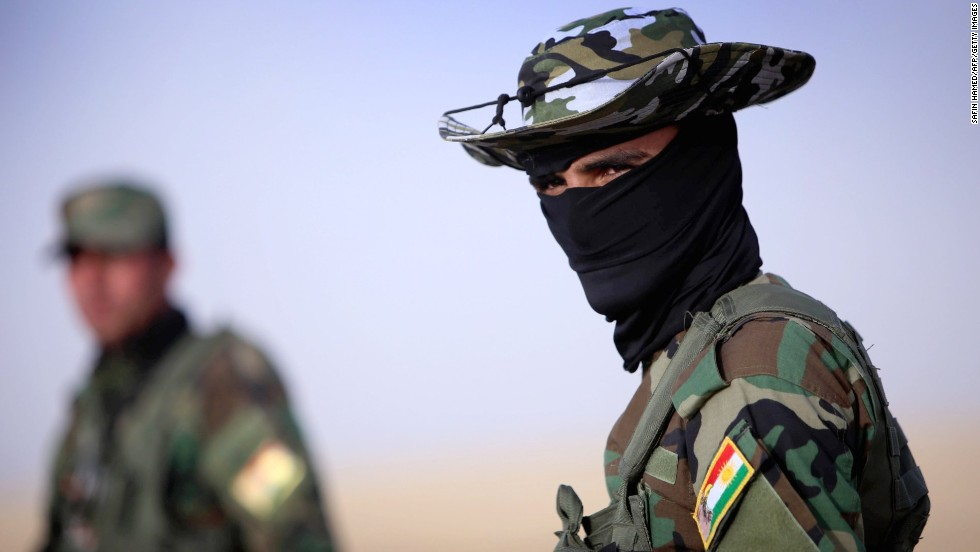 'A security guard is seen at a Kurdish checkpoint on June 11.' from the web at 'http://i2.cdn.turner.com/cnnnext/dam/assets/140611170336-03-iraq-0611-horizontal-large-gallery.jpg'
