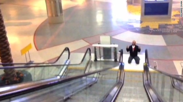 Guy films airport video 'All By Myself'