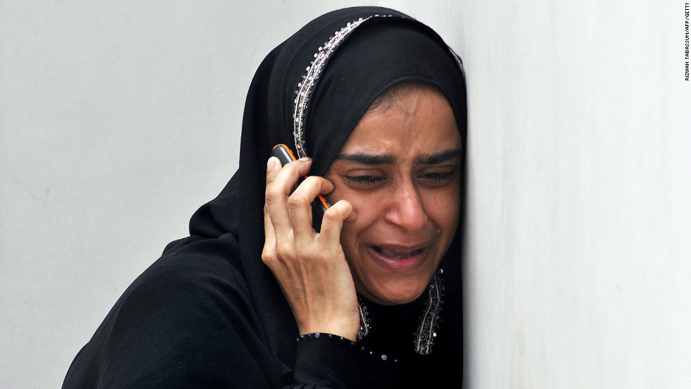 A woman weeps upon receiving news that a relative was killed in an attack on Jinnah International Airport in Karachi, Pakistan. Militants launched the first attack in the cargo area of the airport on June 8, leaving at least 36 people dead, including 10 militants, then struck again on June 10, targeting the Airport Security Forces academy near the airport. The Pakistani Taliban claimed responsibility for both attacks.