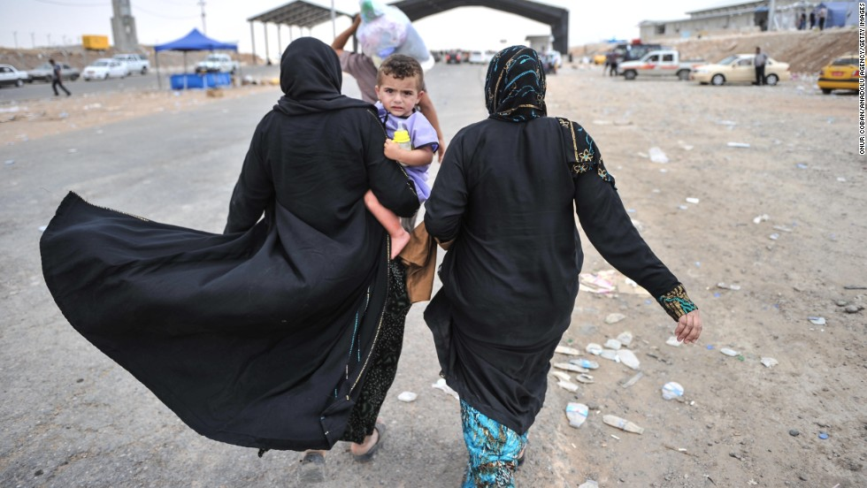 'Iraqi civilians from Mosul escape to a refugee camp near Erbil, Iraq, on Thursday, June 12. More than 500,000 people fled in fear after extremist militants overran Mosul, Iraq's second-largest city, on June 10, the International Organization for Migration said.' from the web at 'http://i2.cdn.turner.com/cnnnext/dam/assets/140612111520-02-iraqi-refugees-0612-restricted-horizontal-large-gallery.jpg'