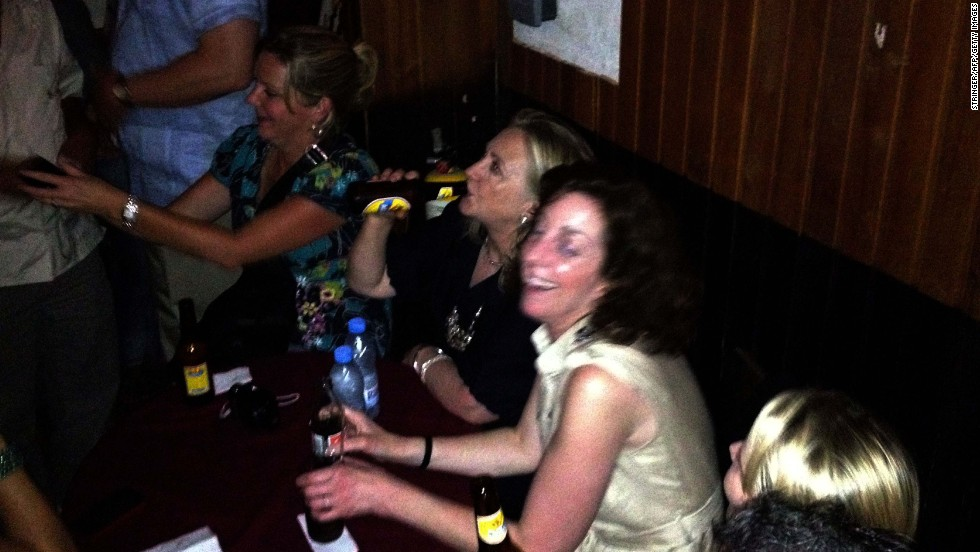 Clinton enjoys a beer at Cafe Havana in Cartagena, Colombia, on April 15, 2012.