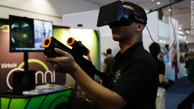 An attendee tries out the Virtuix Oculus Rift setup this month at the Electronic Entertainment Expo in Los Angeles.
