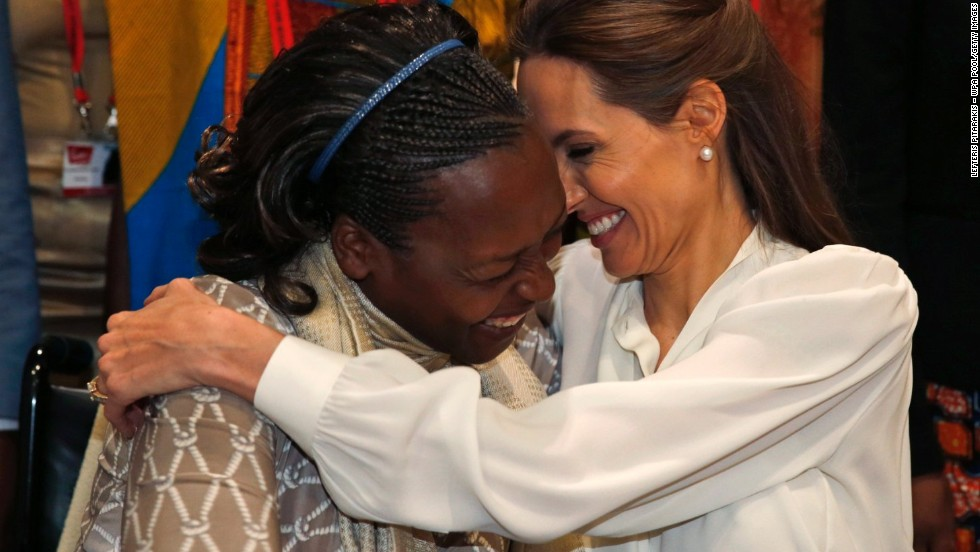 "JUNE 12 - LONDON, ENGLAND: Neema Namadamu from the Democratic Republic of Congo hugs Angelina Jolie, Hollywood star and special envoy for the U.N. High Commissioner for Refugees, at<a href=""http://edition.cnn.com/video/?/video/world/2014/06/11/angelina-jolie-william-hague-christiane-amanpour-sexual-violence-conflict.cnn&hpt=hp_t4&from_homepage=yes&video_referrer=http%3A%2F%2Fedition.cnn.com%2F""> London's 'End Sexual Violence in Conflict' summit</a>. Namadamu formed an organization that uses digital media to empower women demanding peace in eastern Congo after her own 25-year old daughter was attacked."