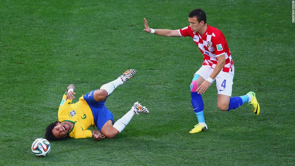 Marcelo falls after a challenge by Croatia's Ivan Perisic.