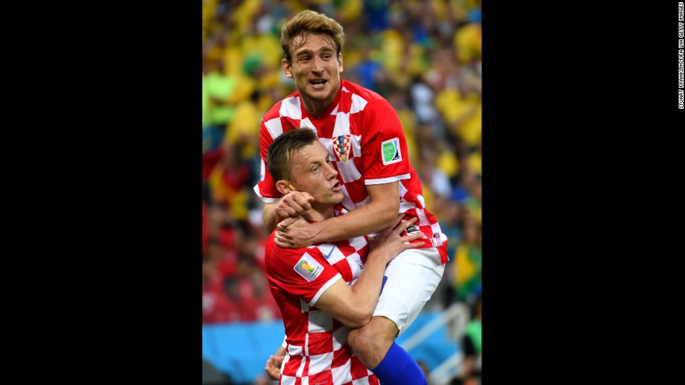 Croatia's Nikica Jelavic, right, celebrates the opening goal with teammate Ivica Olic.