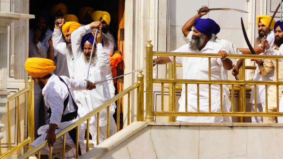 Members of a hardline Sikh group clash with guards of the Golden Temple, the religion's holiest shrine, on Friday, June 6, in Amritsar, India. Half a dozen people were wounded, officials said.