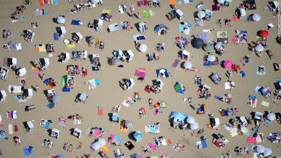 Beachgoers soak up the sun Sunday, June 8, near the Wannsee lake in Berlin.
