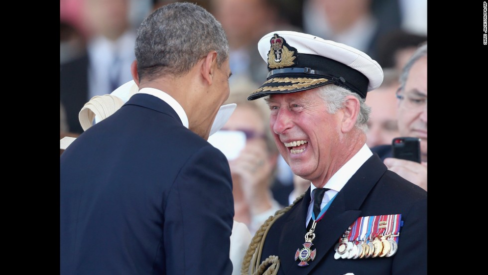 "Britain's Prince Charles laughs as he meets U.S. President Barack Obama during a D-Day anniversary event Friday, June 6, in Ouistreham, France. <a href=""http://www.cnn.com/2014/06/06/europe/gallery/dday-70th-anniversary/index.html"">See more D-Day events</a>"
