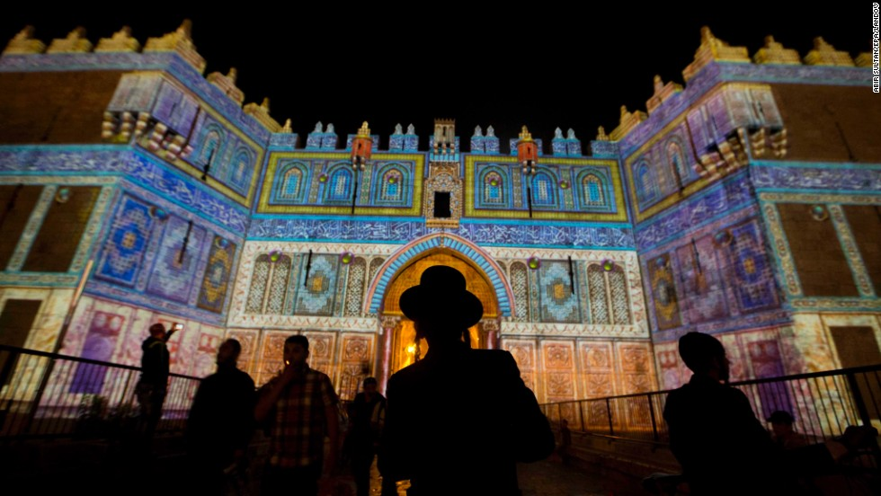 An ultra-Orthodox Jewish man watches a light projection show Thursday, June 12, during the Jerusalem Lights Festival. Several hundred thousand visitors are expected to attend the festival, which runs for a week.