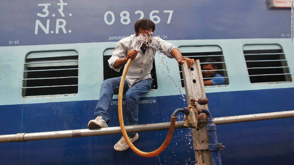 "A man cools off Monday, June 9, with a pipe that supplies water to trains at a railway station in Allahabad, India. <a href=""http://www.cnn.com/2014/06/06/world/gallery/week-in-photos-0606/index.html"">See last week in 32 photos</a>"
