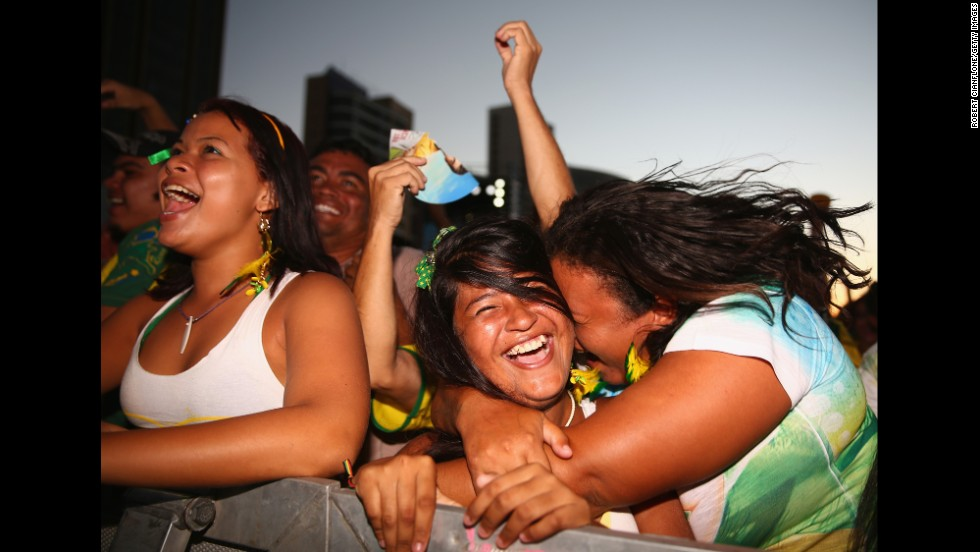 Fans watching the game in Fortaleza, Brazil, celebrate after a Brazil goal.
