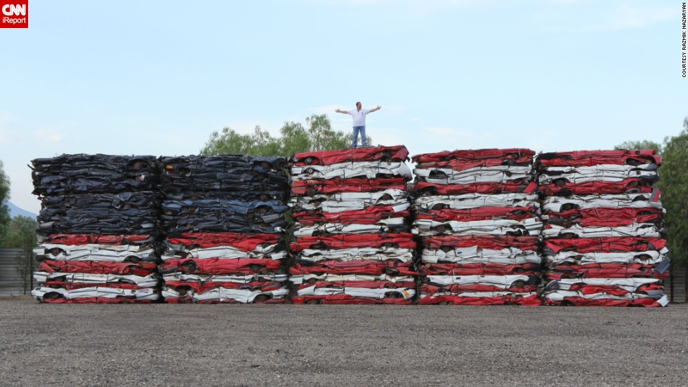 "Talk about patriotism, <a href=""http://ireport.cnn.com/docs/DOC-999591"">Razmik Nazaryan</a> made this colossal American flag with 108 crushed cars. The artist works in auto recycling and was inspired to create his masterpiece in July 2013."