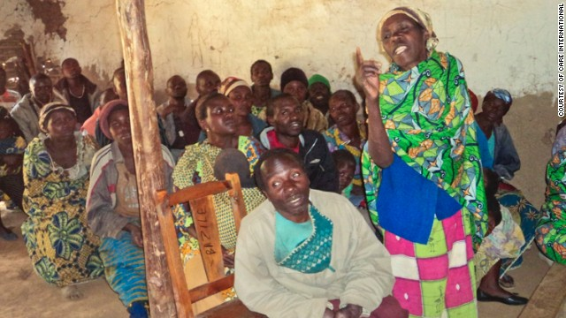 Katungu Mwirawivu offers her opinion in a communal assembly. The 50-year-old mother of 10  lives in Virenge, a village in the Democratic Republic of Congo where CARE worker Michael Alandu trains community members in gender sensitization and equality.