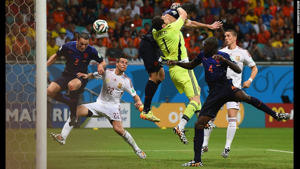 Stefan de Vrij, left, deflects the ball in for the Netherlands' third goal while van Persie collides with Spanish goalkeeper Iker Casillas.