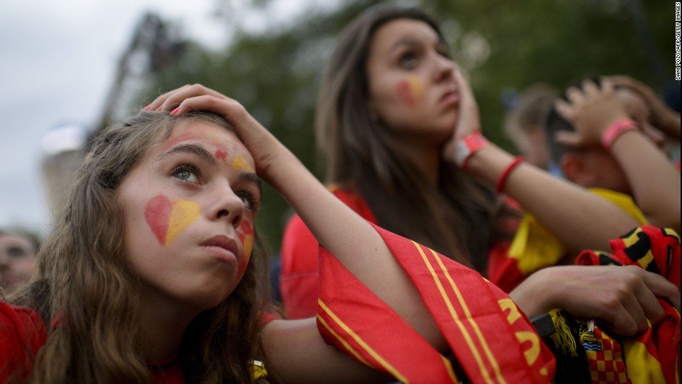 Spain supporters react while watching the game in Madrid.