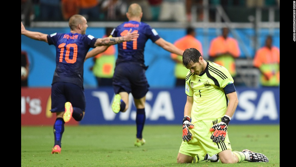 Spanish goalkeeper Iker Casillas, right, reacts after Dutch forward Arjen Robben, center, scored to put the finishing touches on a 5-1 win for the Netherlands on June 13. It was Robben's second goal of the match, which was played in Salvador, Brazil.