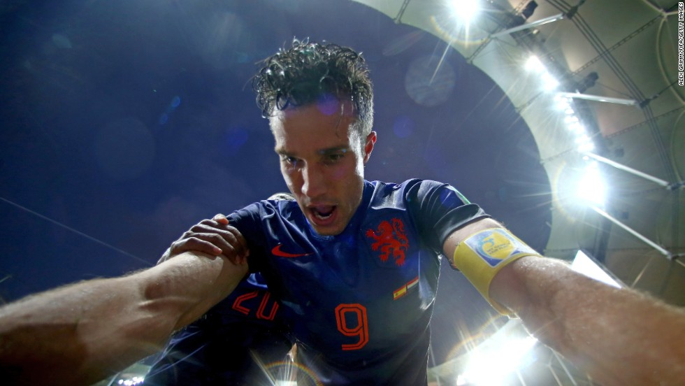 Dutch forward Robin van Persie celebrates after scoring against Spain. He also had two goals in the match.