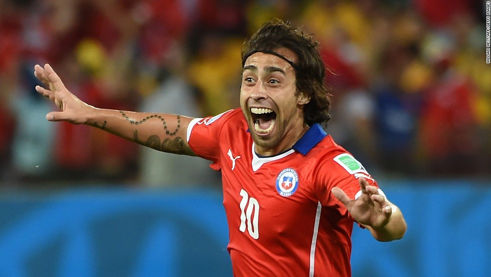 Jorge Valdivia celebrates after scoring a goal to give Chile a 2-0 lead. The goal came less than two minutes after Chile's first goal.
