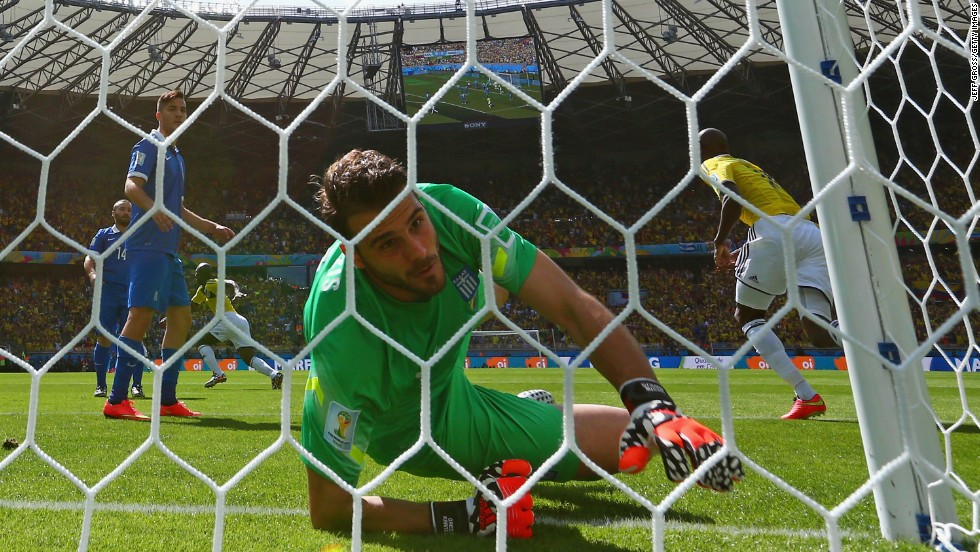 Greece goalkeeper Orestis Karnezis fails to keep out a deflected shot by Colombia's Pablo Armero in the fifth minute of the match.