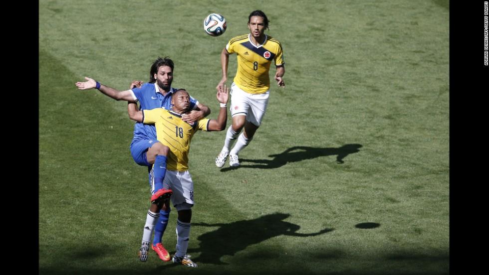 Greece's forward Georgios Samaras, left, vies with Colombia's defender Juan Camilo Zuniga, whose teammate  Abel Agui watches on.