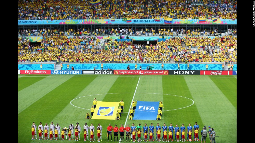 "The Colombia and Greece teams line up ahead of the opening Group C match. <a href=""http://www.cnn.com/2014/06/13/football/gallery/world-cup-0613/index.html"">See the best World Cup photos from June 13.</a>"