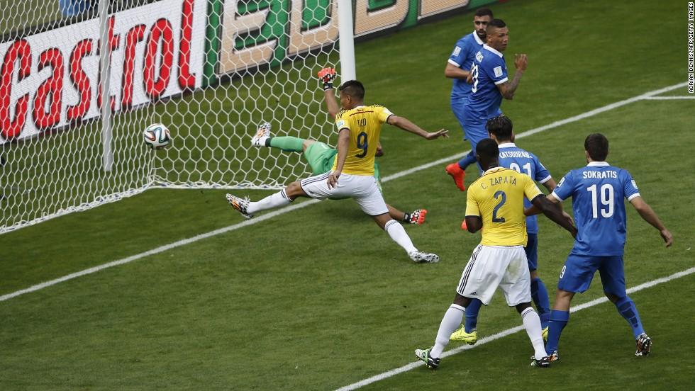 Colombia forward Teofilo Gutierrez scores the second goal.