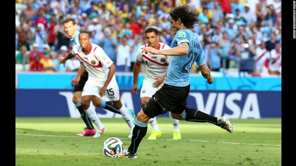 Edinson Cavani puts Uruguay ahead with a first-half penalty kick.