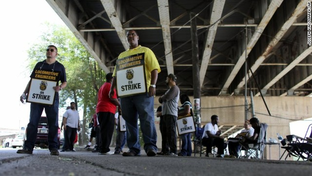 Union members man a picket line outside a railyard in Philadelphia on Saturday.