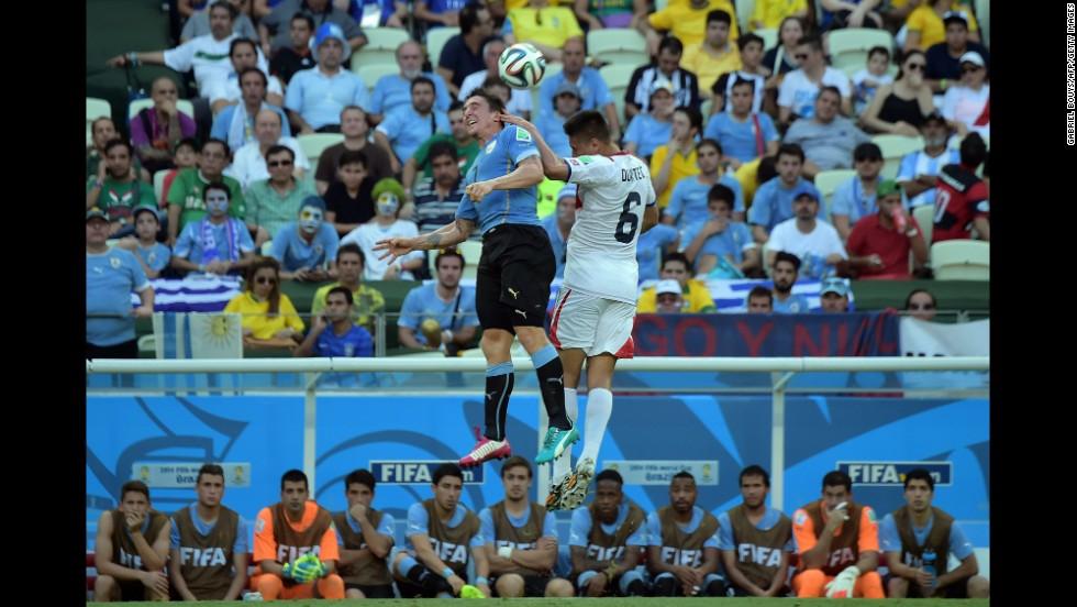 Costa Rica defender Oscar Duarte, right, and Uruguay midfielder Cristian Rodriguez vie for the ball.