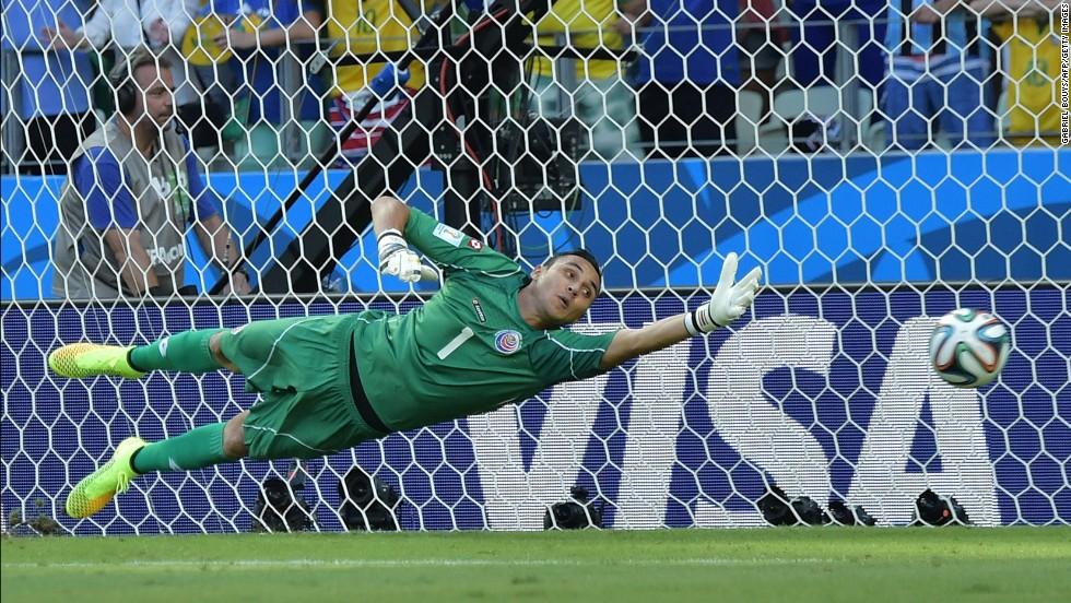 Costa Rica's goalkeeper Keylor Navas fails to save Edinson Cavani's penalty kick.