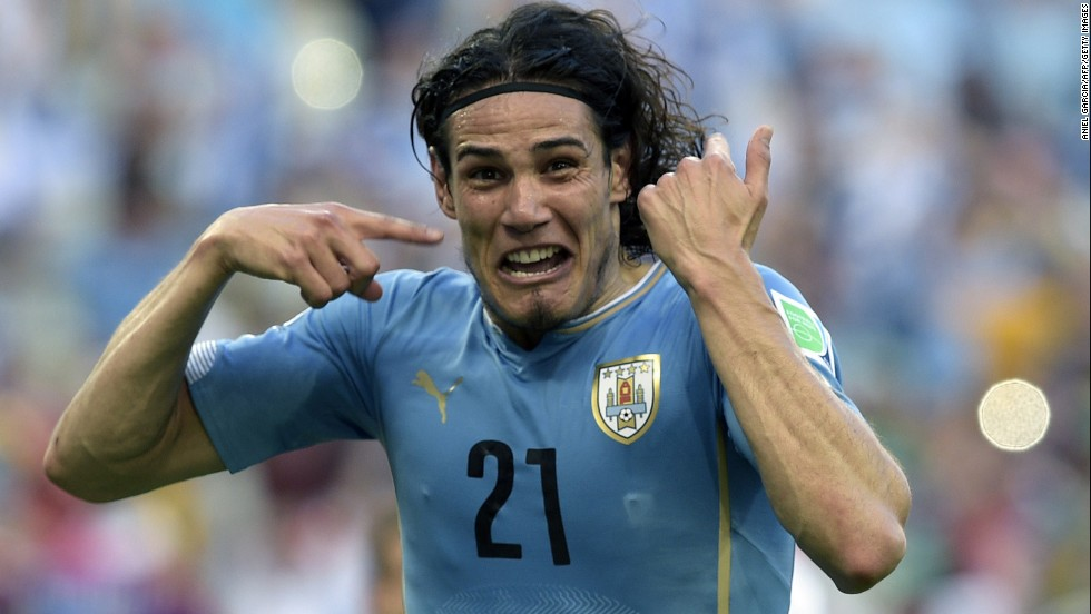 Uruguay forward Edinson Cavani celebrates after scoring in the 23rd minute.