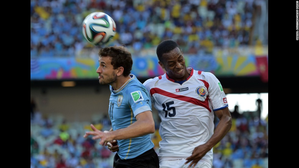 Uruguay forward Christian Stuani, left, and Costa Rica defender Junior Diaz vie for the ball.