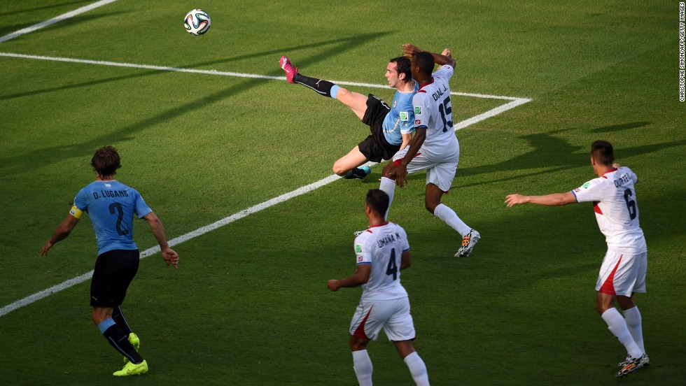 Uruguay defender Diego Godin, top center, has a goal disallowed for offside.