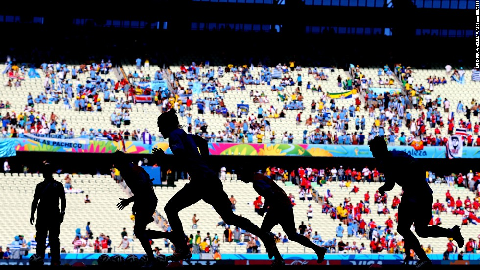 Edinson Cavani of Uruguay, center left, warms up with teammates prior to the World Cup match between Uruguay and Costa Rica.
