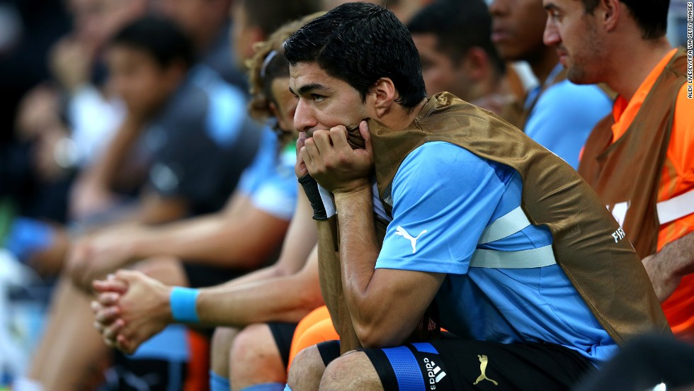 Luis Suarez, Uruguay's star player, watches from the bench. He is still recovering from a pre-tournament injury.