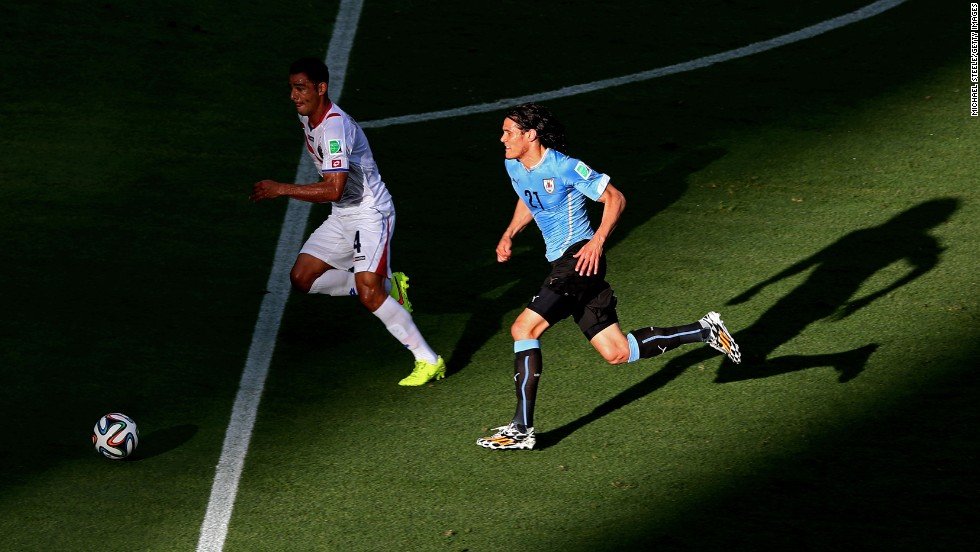Edinson Cavani of Uruguay controls the ball against Michael Umana of Costa Rica.