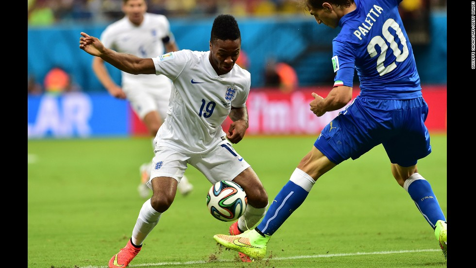England midfielder Raheem Sterling, left, tries to run past Italy defender Gabriel Paletta.