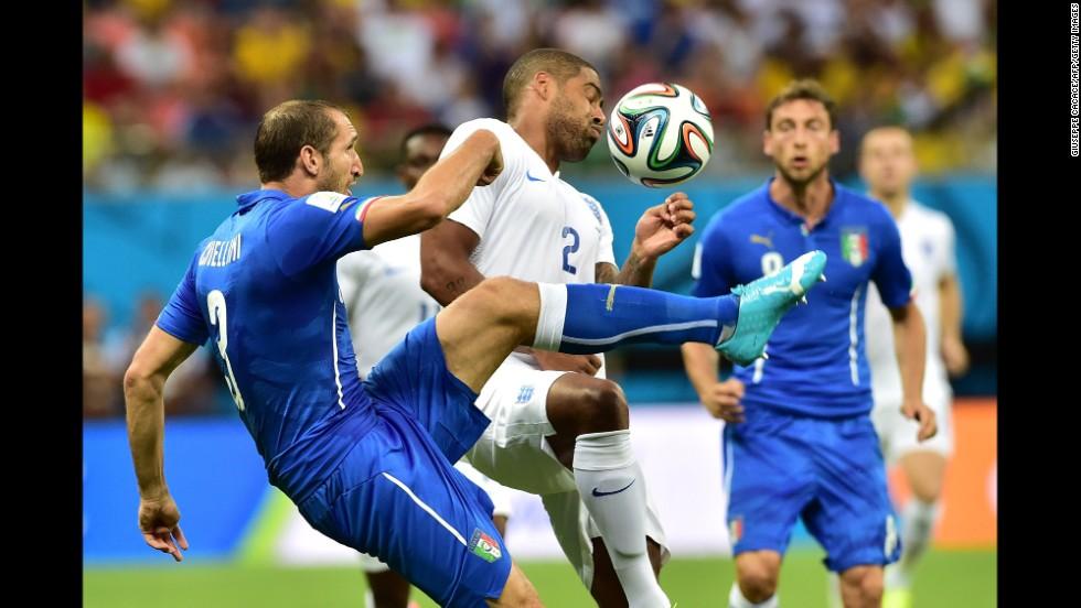 Italy defender Giorgio Chiellini and England full back Glen Johnson vie for the ball.