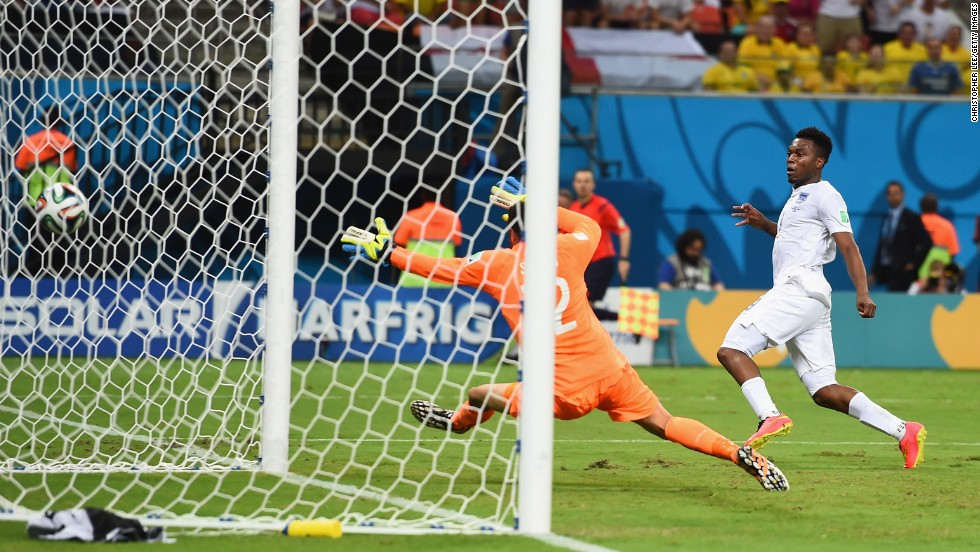 Striker Daniel Sturridge equalizes for England against Italy, beating goalkeeper Salvatore Sirigu.