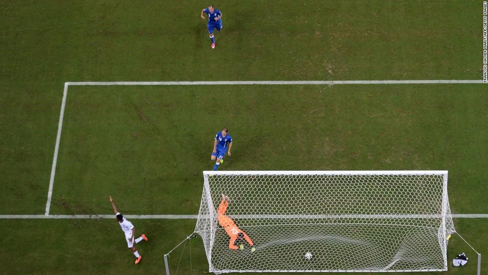 England forward Daniel Sturridge, left, scores a first-half leveler.