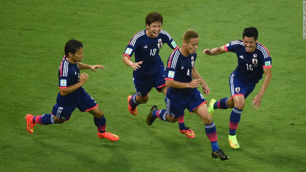 Keisuke Honda, second from right, celebrates scoring Japan's first goal with teammates Yuto Nagatomo, Yuya Osako and Hotaru Yamaguchi.