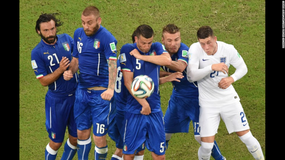 Italian players jump during a free kick during a World Cup match against England at the Amazonia Arena in Manaus, Brazil, on June 14. Italy defeated England 2-1.