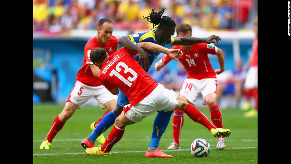 Ricardo Rodriguez of Switzerland challenges Felipe Caicedo of Ecuador.