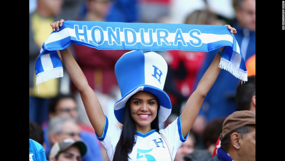 A Honduras fan holds up a banner as she cheers on her team.
