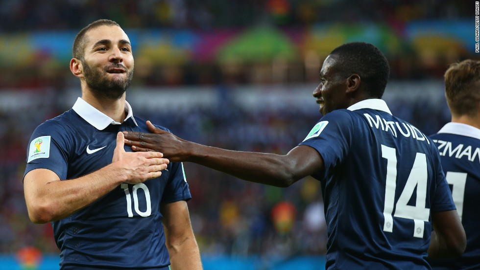 Karim Benzema, left, celebrates with teammate Blaise Matuidi after scoring France's third goal against Honduras on June 15. It was his second goal of the match, which France won 3-0 in Porto Alegre, Brazil.