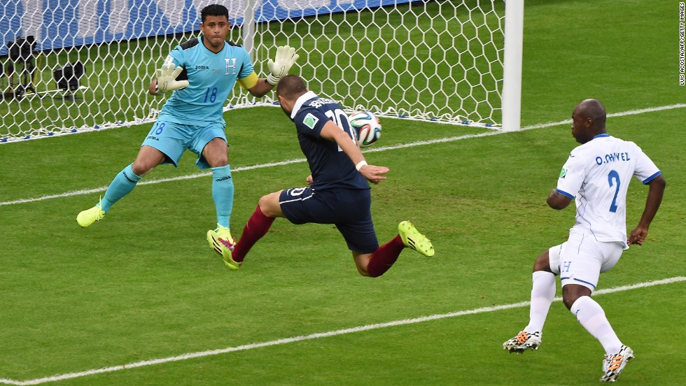 France forward Karim Benzema, center,  shoots past Honduras' goalkeeper Noel Valladares.