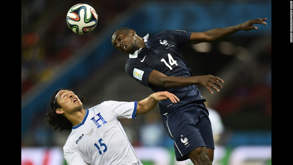 Honduras midfielder Roger Espinoza, left, and France midfielder Blaise Matuidi vie for the ball.