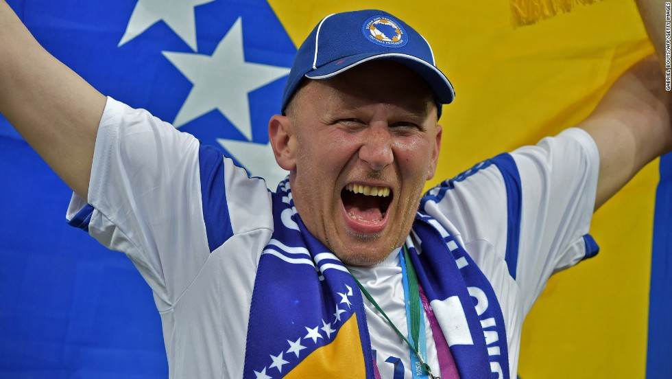 A Bosnian fan cheers for his team ahead of the match.