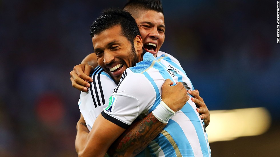 Marcos Rojo and Ezequiel Garay of Argentina celebrate their team's first goal.